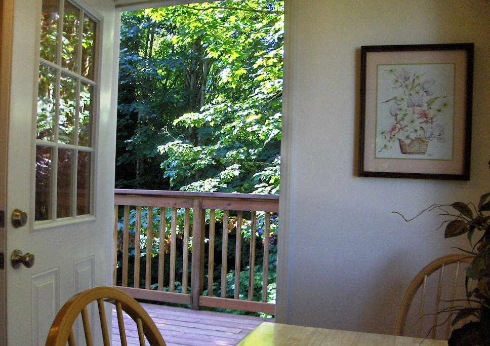 Deck, off the kitchen overlooks a greenbelt filled with wildlife.
