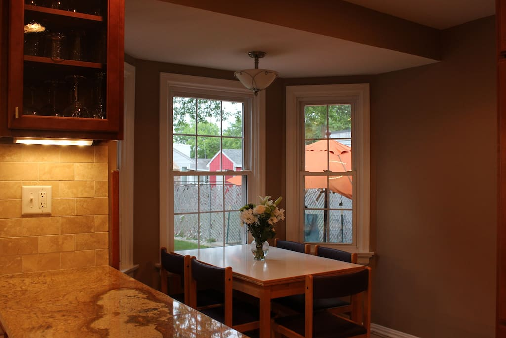 Spacious eat in kitchen with expandable table for the perfect dinner party