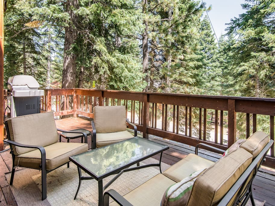 Soak up the sunshine on the deck overlooking the pines.