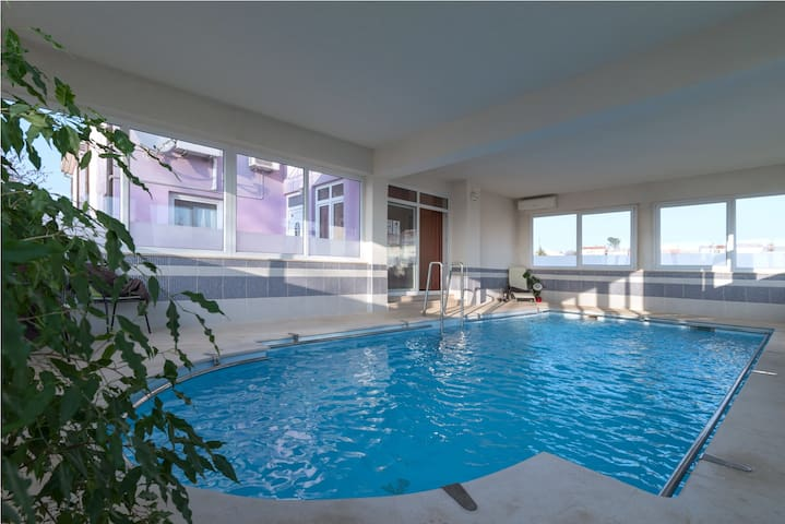 Apartment Orange with an inside swimming pool