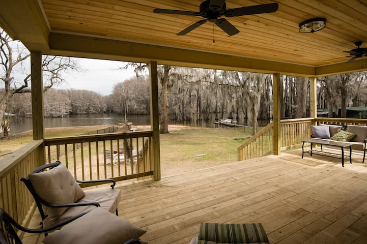 Come enjoy our porch for relaxing and listening to all the sounds of nature. We screened the porch in, not show in this photo.