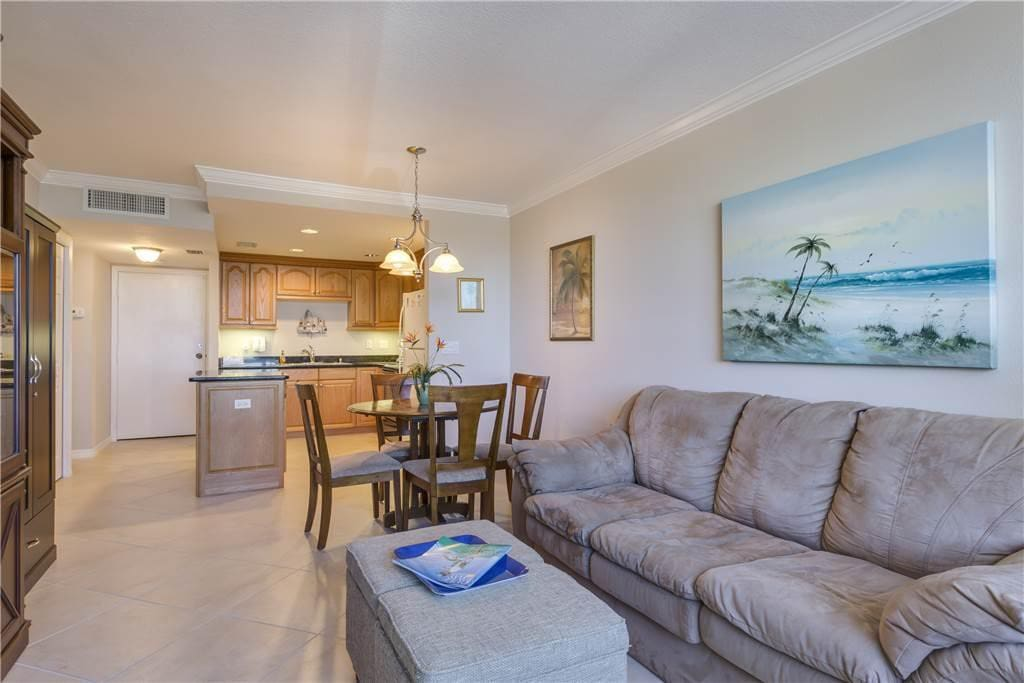 A view of our beautifully furnished living room with a new HDTV - Take a step inside our vacation rental and you'll pick up on a