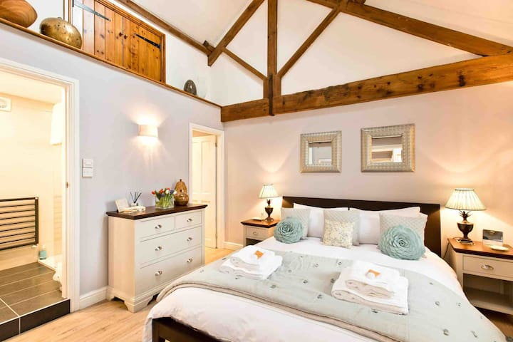 The master bedroom, with super comfy Hulsta king size bed,  newly fitted modern en suite shower room and walk in wardrobe.