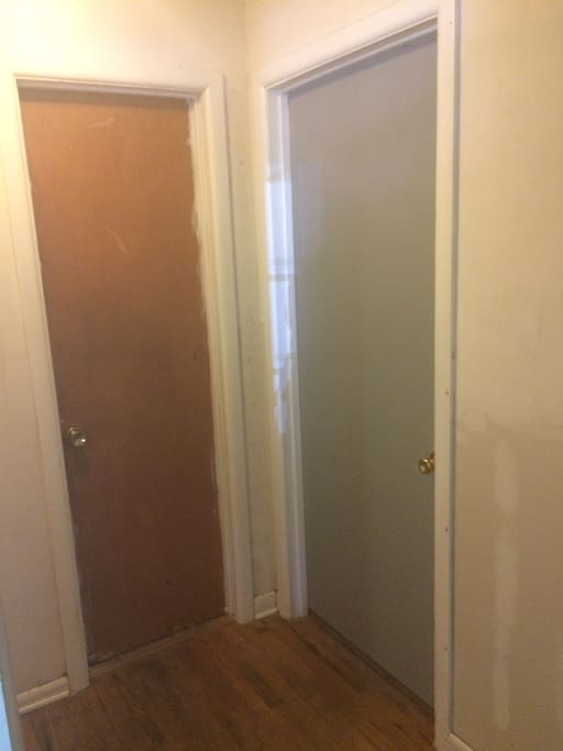 The grey door is the guest room you'll use. The brown one beside it is the private bathroom with lock that is exclusively for your use