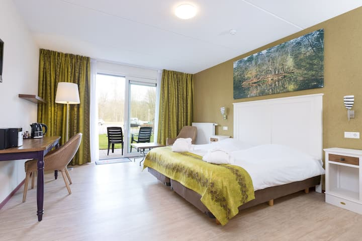 Chambre d'hôtel confortable avec accès au centre de bien-être