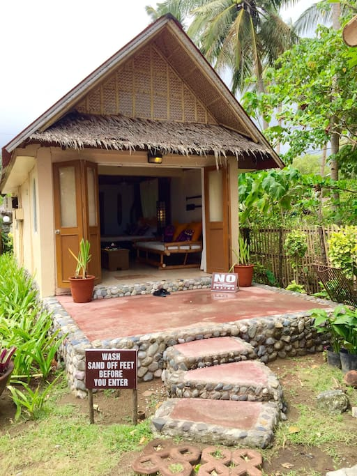 Your cozy bungalow, doors fully open to get a great view of the garden and Jawili beach beyond