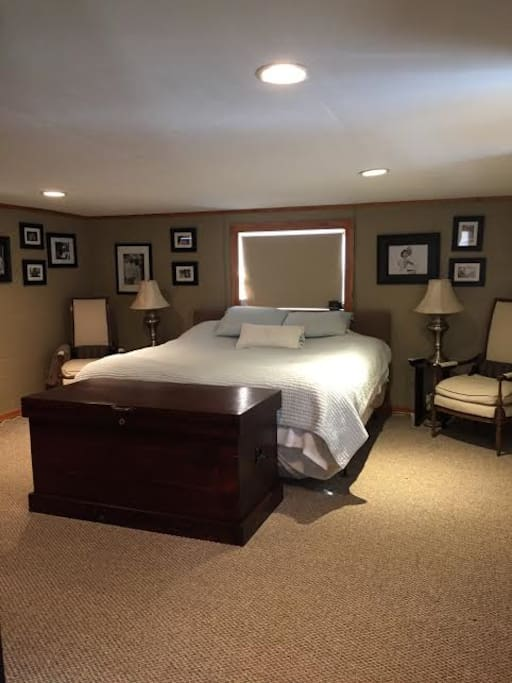 Spacious bedroom with room darkening shades for those who like to sleep in. The Bedroom is upstairs and have separate heating and cooling system to keep you comfortable.