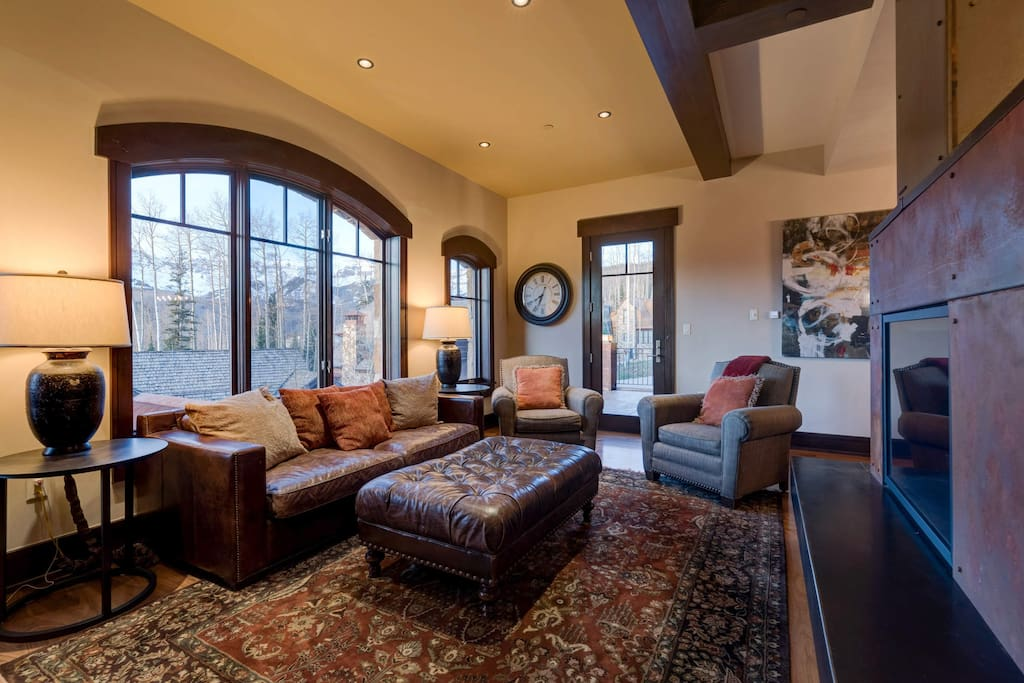 Perhaps face the fireplace, as there is plenty of comfortable seating throughout the living room.