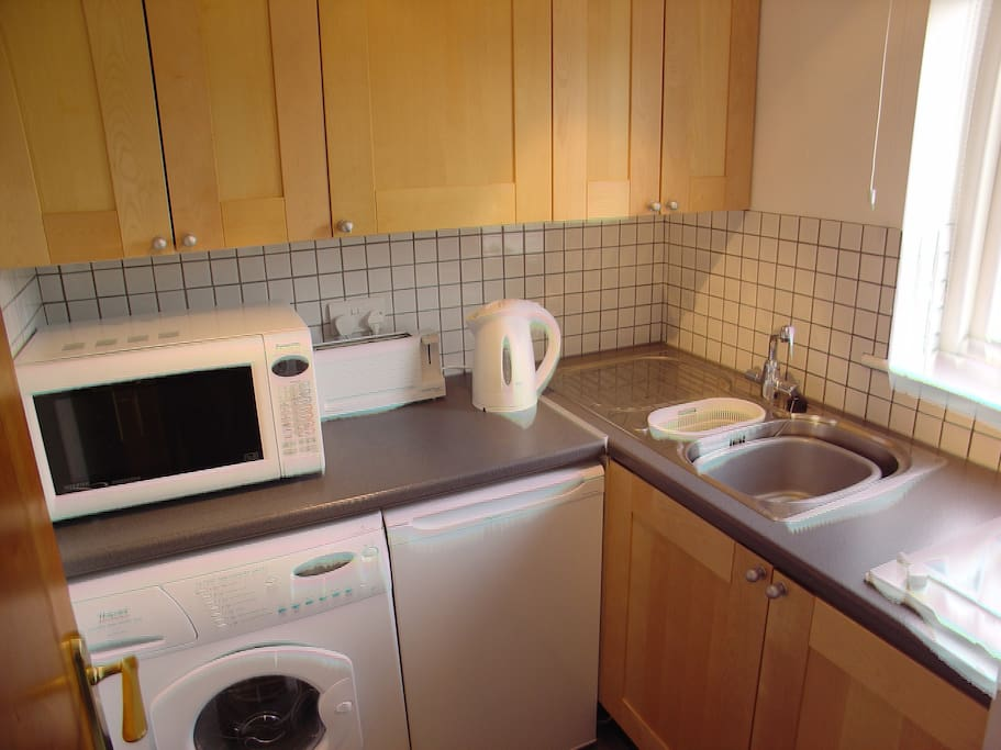 Small kitchen with washing and cooking facilities