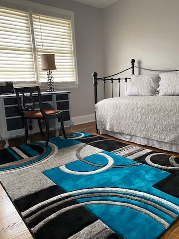 Bedroom #3 has a twin daybed with twin trundle bed, desk with chair, closet and ceiling fan.