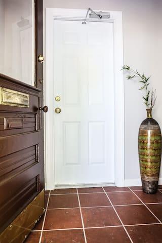 SHARED ENTRYWAY AND PRIVATE APARTMENT DOOR