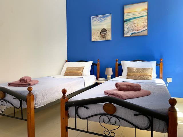 New standard size single beds, new bedsheets and bedspread. Have Fan and air conditioner.