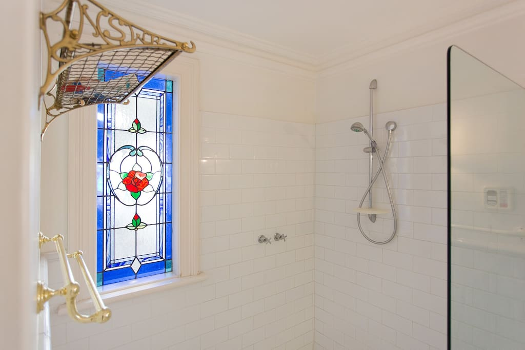 The shower and stained glass window