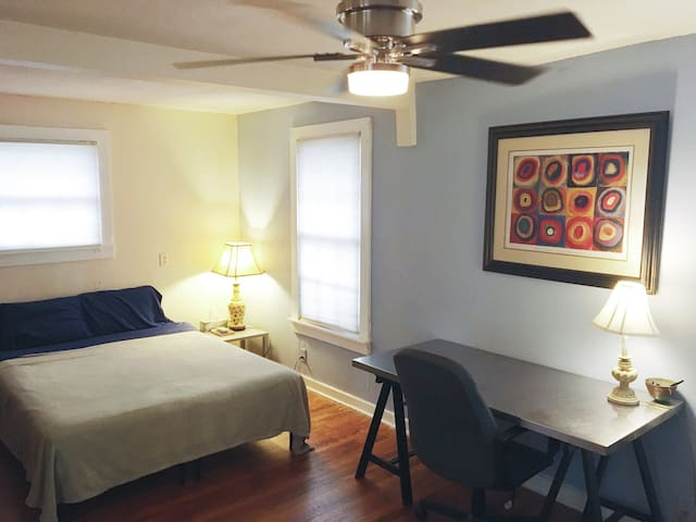 Guest bedroom - comfortable queen sized bed and space for work or lounging