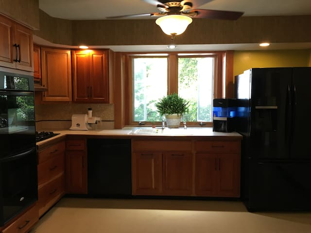 This handcrafted Cherry-wood kitchen is a wonderful space place to cook in even if its just a few meals. Large French Door fridge, dishwasher, 2 ovens, gas top stove and garbage disposal. Microwave and toaster oven as well as a whole coffee bar.