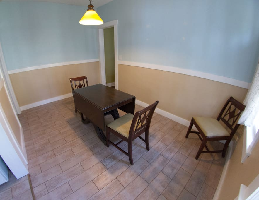Dining room with drop leaf table. Seats up to six.