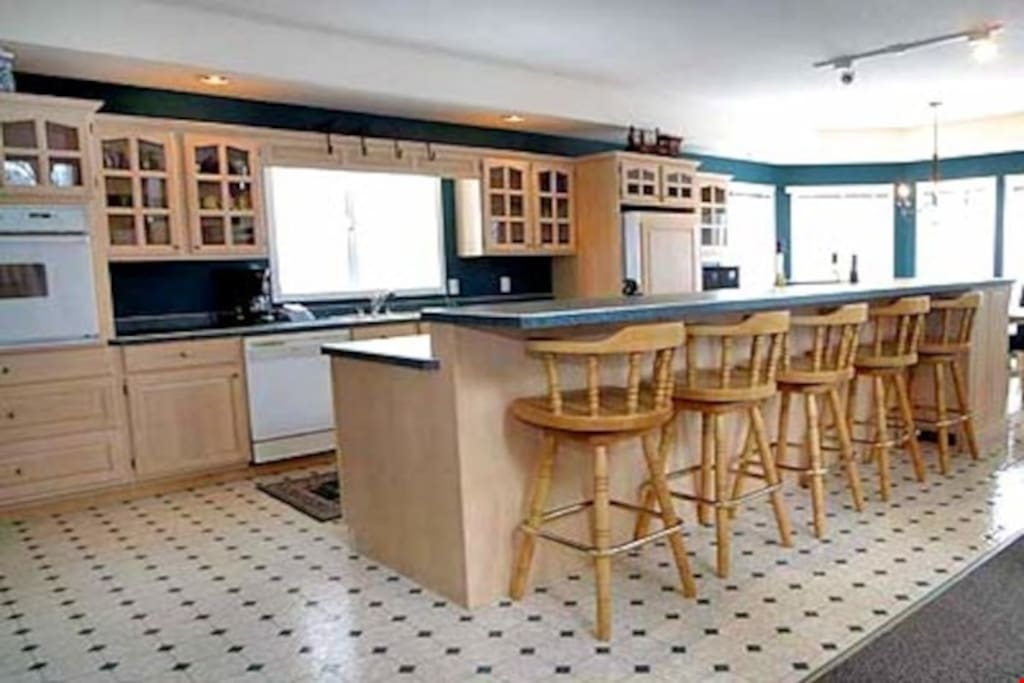 Prepare meals in the fully equipped kitchen, complete with breakfast bar and stools.