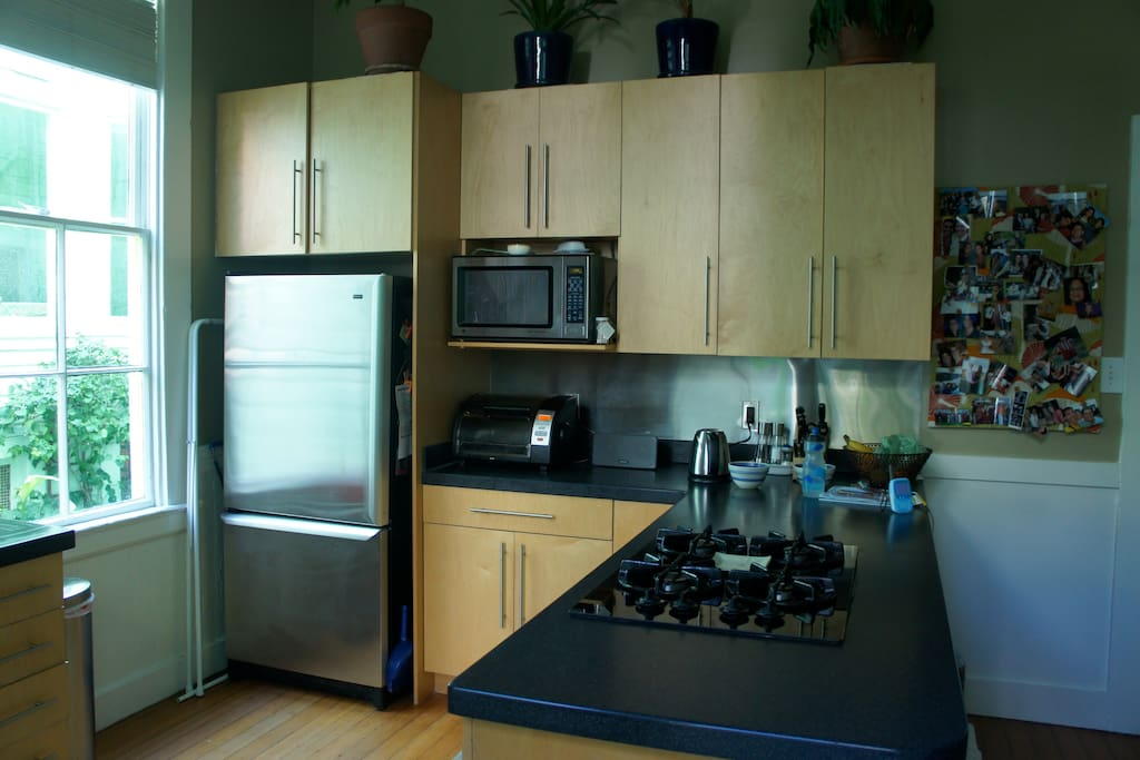 Our kitchen is big and comfortable. We have stainless steel appliances and an island stove that's perfect for hanging out around while someone's cooking.