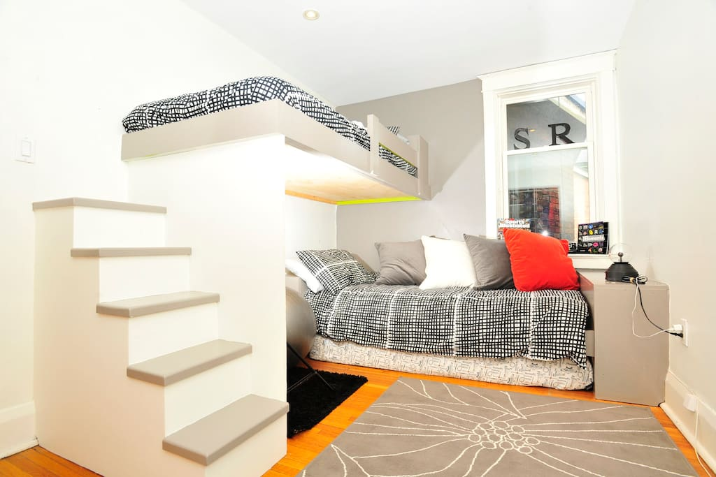 The custom-built bunks with easy stairway to the top bed.