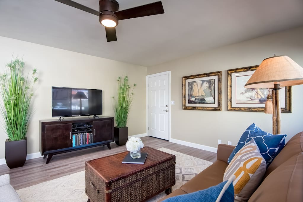 The living room includes and HD TV with cable, perfect for unwinding after a long day at the beach.