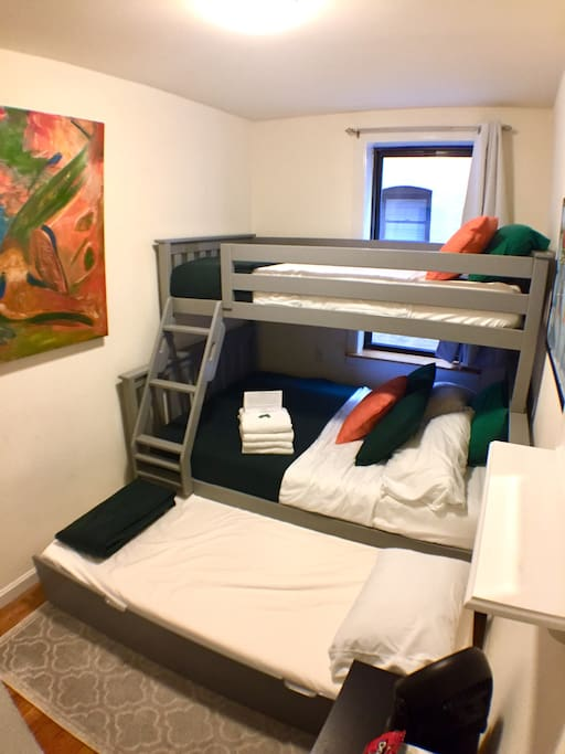 Trundle bed allows for a 4th person to stay here! It's a tight squeeze with 4 people, but it allows for some flexibility for people to stay somewhere cheaply if they don't mind the small space!