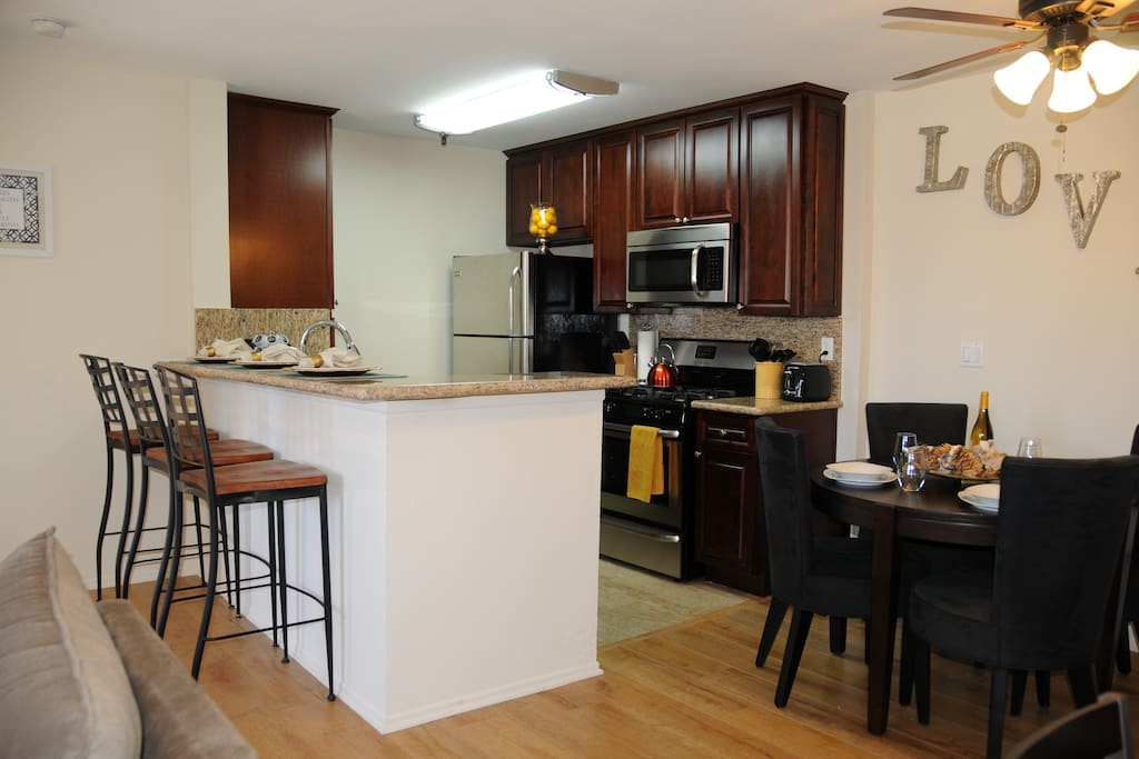 The kitchen is fully equipped for you to cook. The kitchen counter seats 3. The dining room table seats 4.