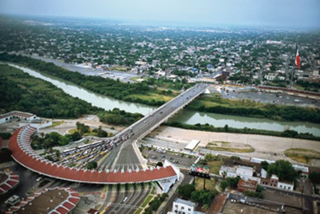 USA and Mexico divided by the Rio Grande River.  Laredo,Texas Laredo is the U.S. principal port of entry into Mexico, connecting IH-35 with the Pan American Highway, that stretches into Central and South America.