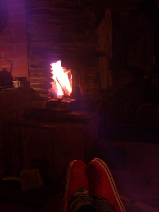 Someone's shoes and a fire.