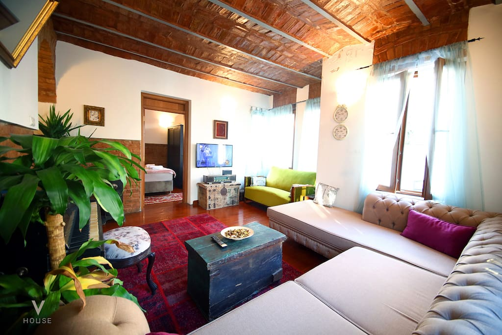 very spacious and comfortable lounge furnished with antique furnishings