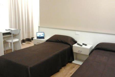 two single beds in a private room - Quarto d'Altino