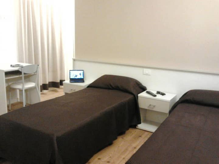 two single beds in a private room