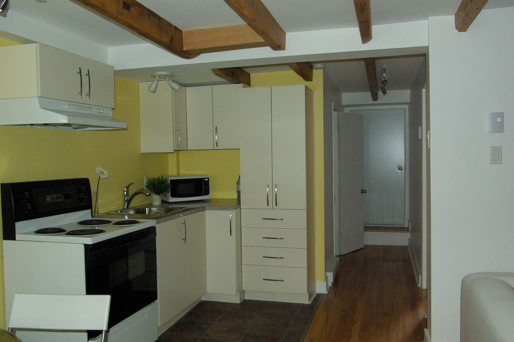 Kitchen and corridor: bathroom on the left, bedroom on the right and emergency exit.