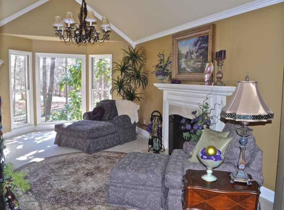 In-suite master sitting room with fireplace, down lounging chairs, TV with cable and wireless internet.