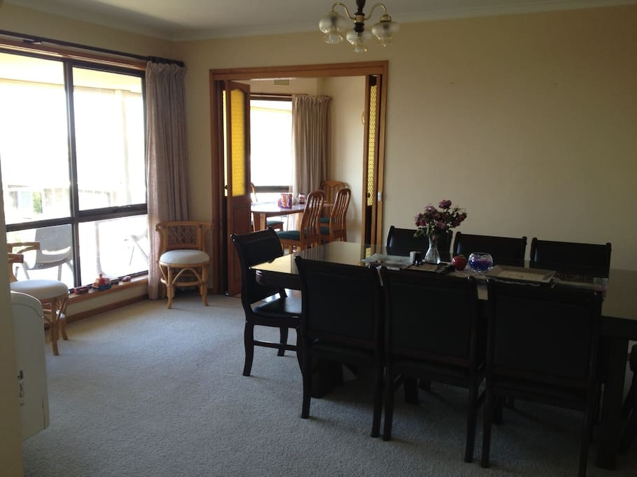 Our dining area through to the kitchen, with the balcony outside