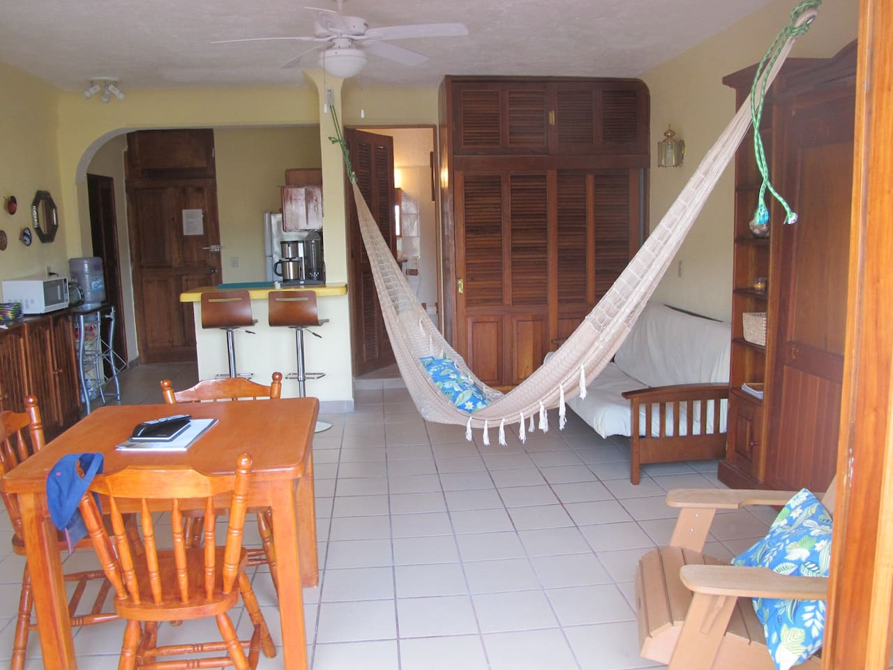 Living room, kitchen at hammock at Siesta Y Sol.