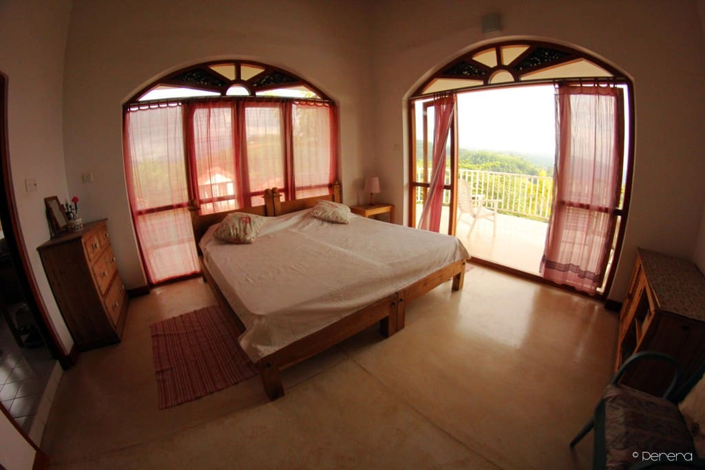 Plight and airy room in the main house with large balcony.