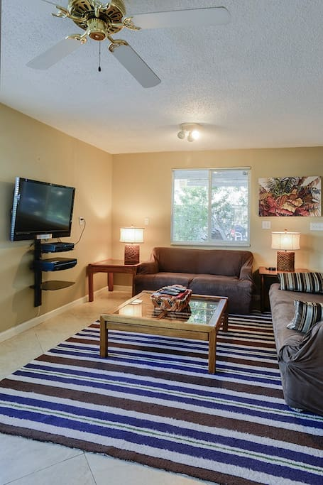 Back living area with sofa, loveseat, HDTV