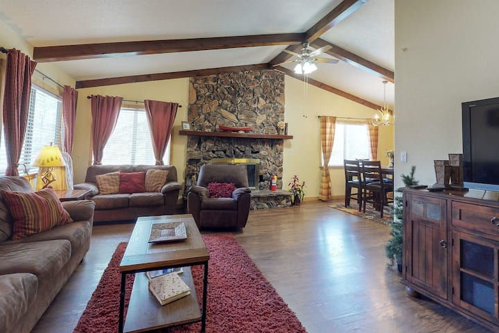 Family-sized home with game rooms, wood fireplace, backyard, patio, & grill