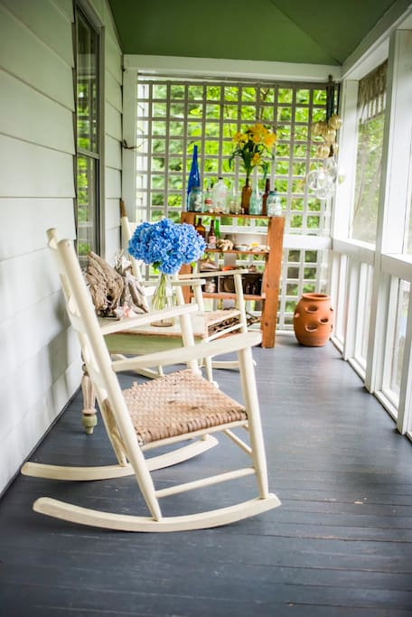A cup of coffee and the paper on the front porch? Yes please!! Two rocking chairs.