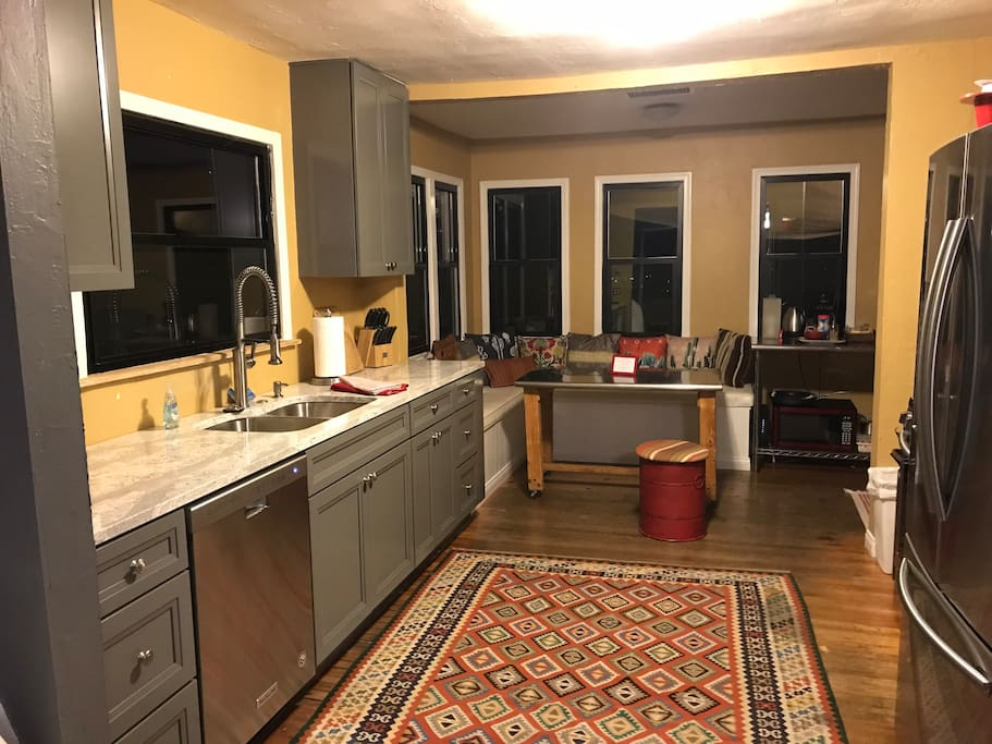 New Kitchen opens to a wood deck and private backyard