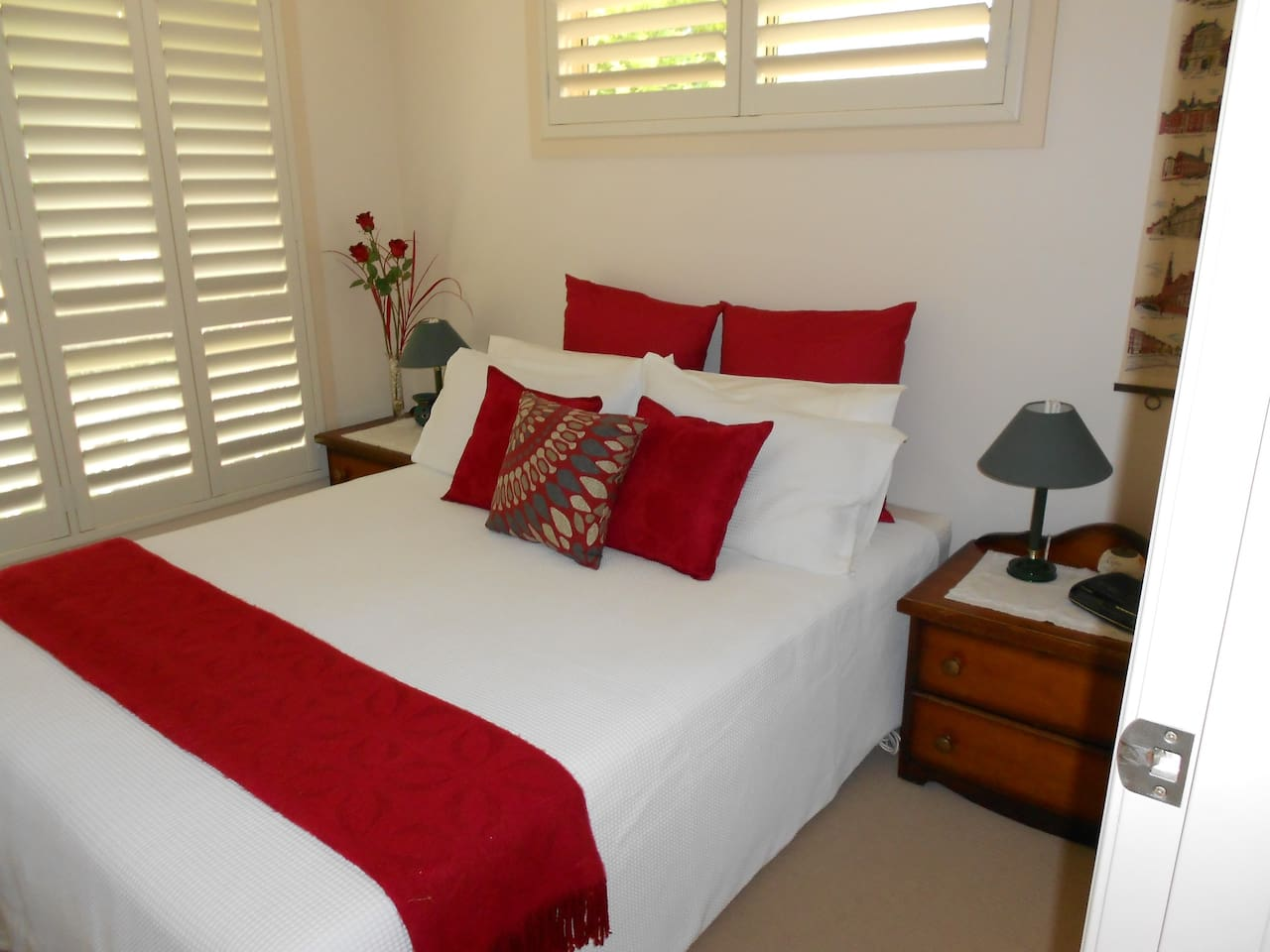 Light airy room with queen bed, bedside tables and built-in wardrobe.  Bedroom overlooks front garden.