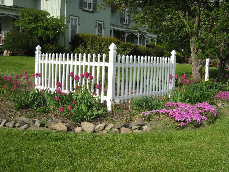 Look for the picket fence on the corner of the property when you drive up!