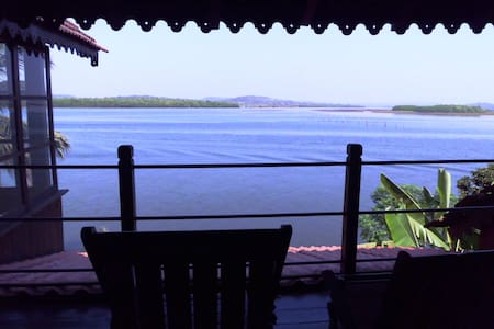 A true wooden Chalet situated on the Banks of Goa's largest rivers.