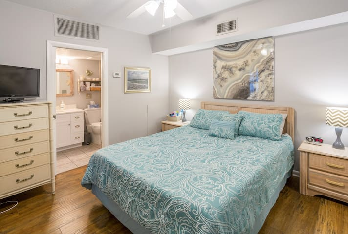 Light and airy master suite has a queen- sized memory foam bed, with lots of linen and pillow choices, ceiling fan, plenty of storage, and a Smart TV with cable and streaming services.