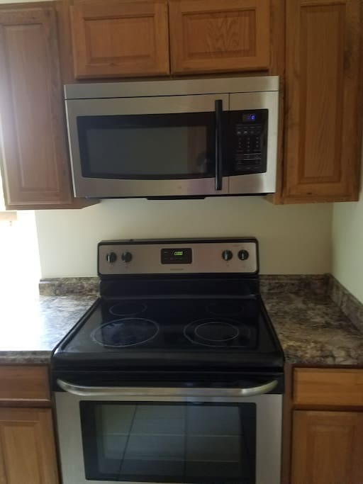 New appliances including a flat top stove in the kitchen