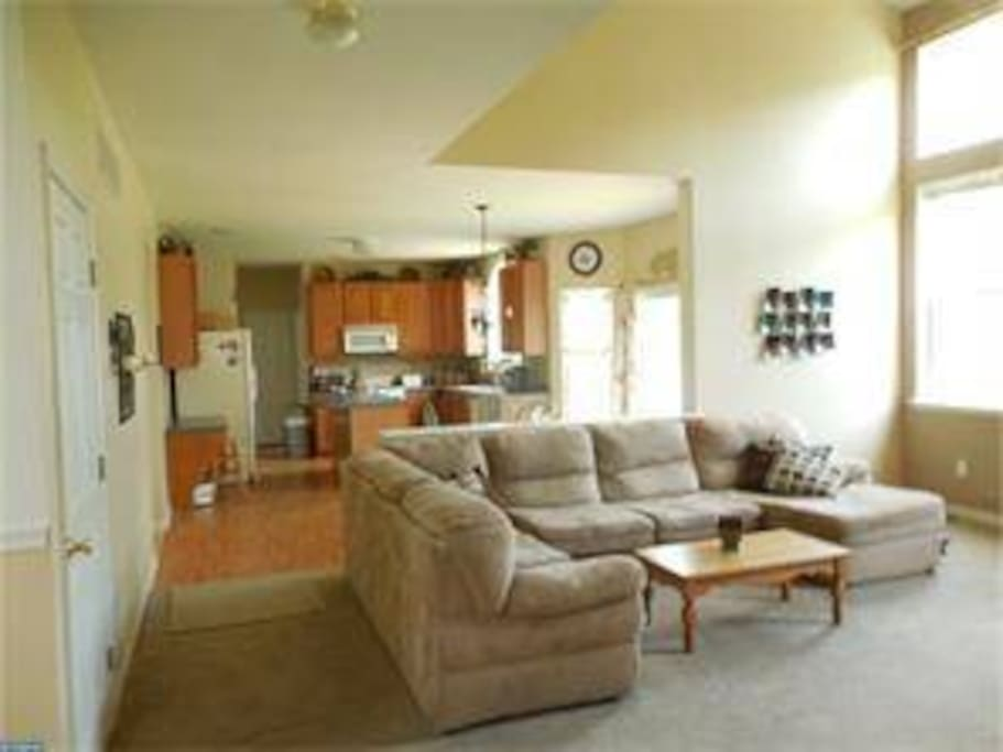 Family room that flows into the kitchen and back door to patio.