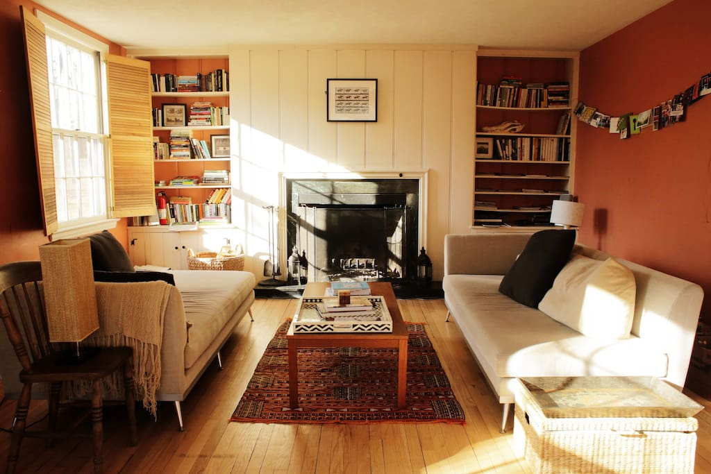 This living room faces southwest and is sunny all day long. A great place for reading a book, playing a game of cards, or curling up by the fire.