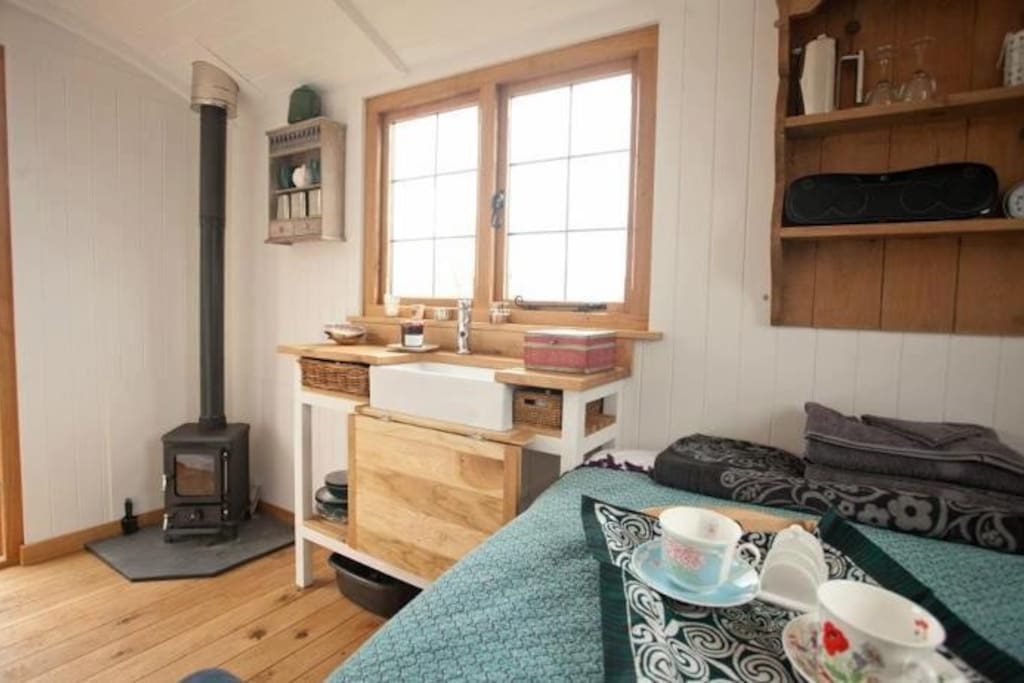 Inside your hut - oak fixtures and fittings, woodburner, water, electricity, tea and coffee making, plus lots of home comforts.