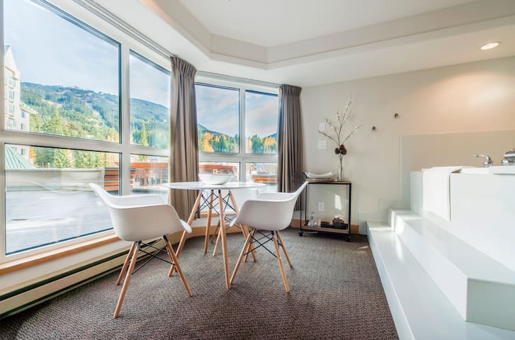 Dining area with mountain views.