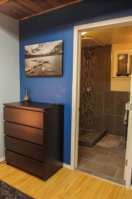 Direct entrance to remodeled bathroom from bedroom